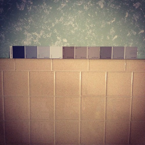 It begins. (Tile stays for a while - paint and wallpaper border go. Soon. Choosing replacement color - I like the greys)