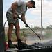 Montana sprays off a truck