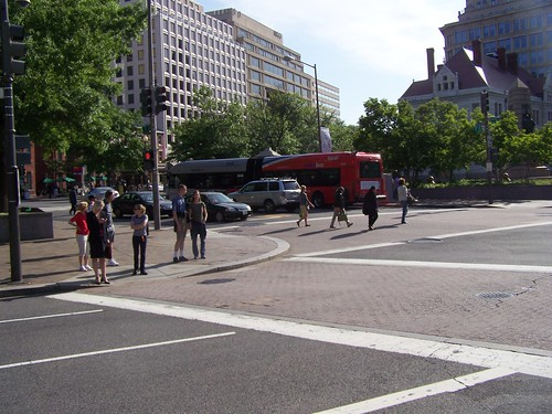 People waiting at the crosswalk, 7th St. and Pennsylvania Avenue NW