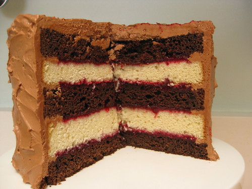 A peek inside the cake (Chocolate-Vanilla Layer Cake with Raspberry Filling and Chocolate Mousse Buttercream)