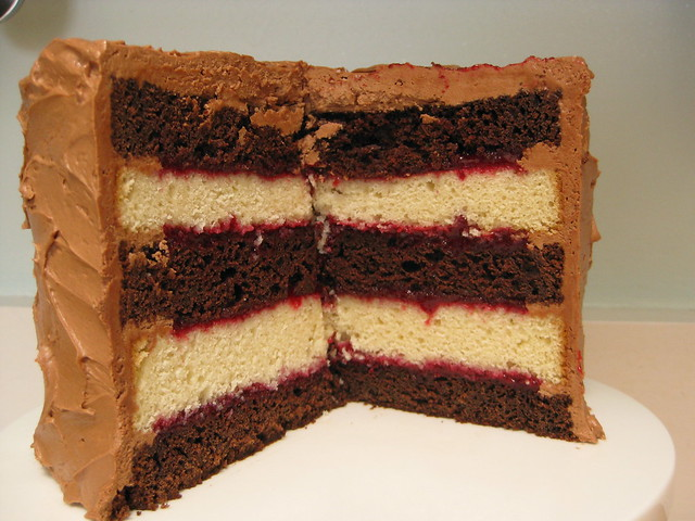 chocolate-vanilla layer cake with raspberry filling and ch ...