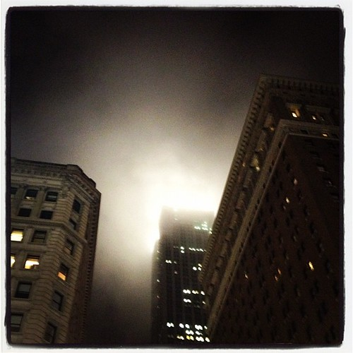 The EMpire State Building all draped in fog