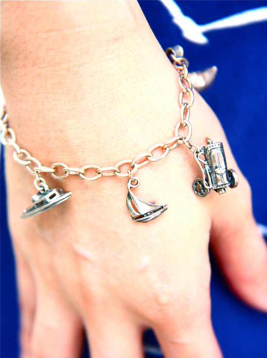Vintage silver charm bracelet with boat and automobile charms.