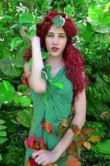 clothing, red, green, photo shoot, fictional character, costume, jungle, beauty,
