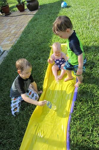 3 babies on a slide