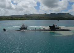 USS Topeka (SSN 754) comes alongside submarine tender USS Emory S. Land (AS 39) in Guam in May 2012. (U.S. Navy file photo/MC1 David R. Krigbaum)