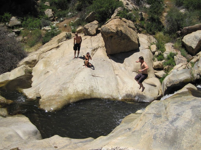 Jumping into the pool at Green Valley Falls