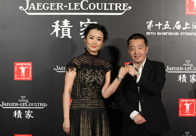 Director Jia Zhangke wearing Jaeger-LeCoultre Eight Days Calendar Perpetual and actress Zhao Tao wearing Jaeger-LeCoultre Rendez-Vous at SIFF 2012 - 11