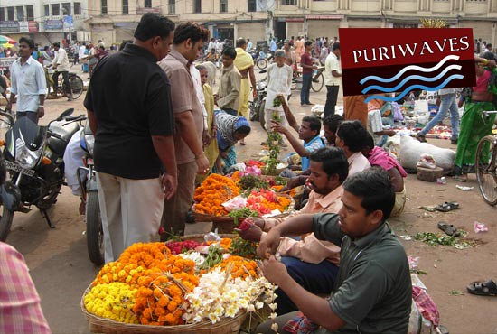 Flower garland is being sold at Grand road Puri