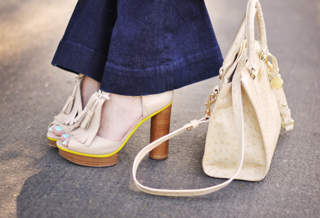 wood platforms with yellow stripe and brahmin tote bag