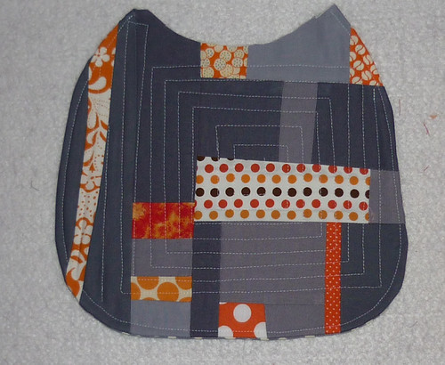 Grey and Orange bib for Théo by Kindred Crafters