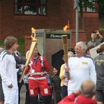 Both Flames lit. Olympic torch carried through Burslem