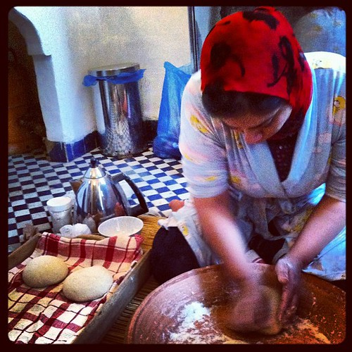 Bread making!!!! Another HUGE Moroccan breakfast! Different breads baked & fried, jams, tagine of eggs, tea, coffee, yogurt, etc etc etc.  #morocco #travel #tripofalifetime #fes #fez #bread #breadmaking by sarahdabearah