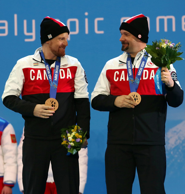 Chris Williamson and Nick Brush celebrate their bronze medal win in the slalom in Sochi, RUS at the Paralympic Winter Games