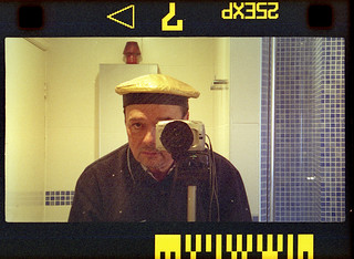 reflected self-portrait with Minolta Vectis S-100 camera and gold cap