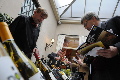 Brothers Geert (left) and Jan Desmet (center), owners of Vinam, a California wine specialist company in Belgium, offer samples to guests at the March 7 wine tasting organized by the Foreign Agricultural Service (FAS) in cooperation with the Wine Institute.  (Photo Courtesy of the U.S. Embassy in Belgium)Brothers Geert (left) and Jan Desmet (center), owners of Vinam, a California wine specialist company in Belgium, offer samples to guests at the March 7 wine tasting organized by the Foreign Agricultural Service (FAS) in cooperation with the Wine Institute.  (Photo Courtesy of the U.S. Embassy in Belgium)