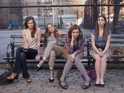 the cast of HBO's Girls sitting on a bench