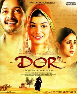 The poster for Dor. It is bright, with the face a smiling woman with a beautiful veil in the center. In the upper left corner is a man's face, looking away from the camera but optimistic. In the bottom right is another woman's face. She is not wearing a veil and has a troubled expression.