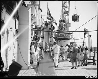 Children on a slippery slide on board HMAS CANBERRA, 12 December 1931