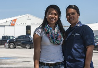 Juanita Collins, Coast Guard Military Child of the Year, poses with her mother, Chief Petty Officer Tafaoga Collins, a yeoman at Air Station Clearwater, Fla., at the station Tuesday, April 1, 2014. From a pool of nearly 1,000 nominees, Collins was chosen as the 2014 Coast Guard's military child of the year by a committee of active duty and retired military personnel, spouses of senior military leaders, veteran service organization leadership, teachers, and community members. (U.S. Coast Guard photo by Petty Officer 2nd Class Michael De Nyse)