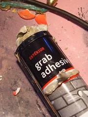 Grab adhesive