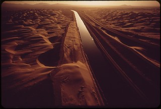 All-American Canal carries Colorado River water through sand-swept area of the Imperial Valley, May 1972