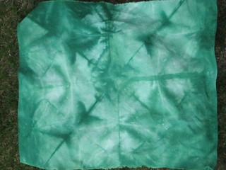 hand dyed by folding fabric in triangles