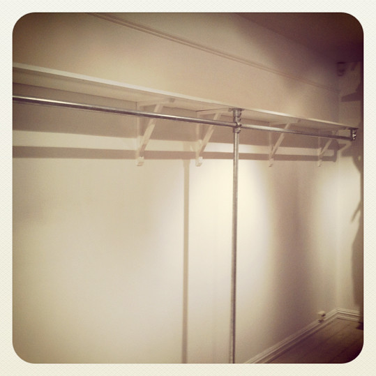 Shelf Mounted Clothing Rack