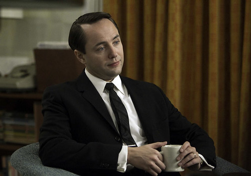Pete Campbell looking smug sitting at his desk