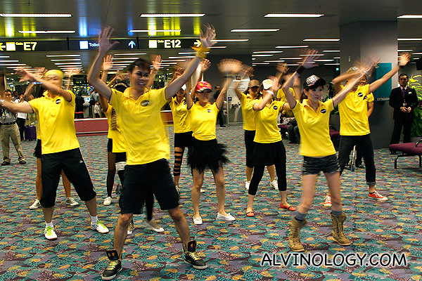 Scoot cabin crew dancing at Changi Airport, just hours before the inaugural flight last year