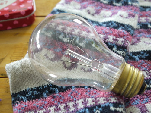 sock darning with a lightbulb