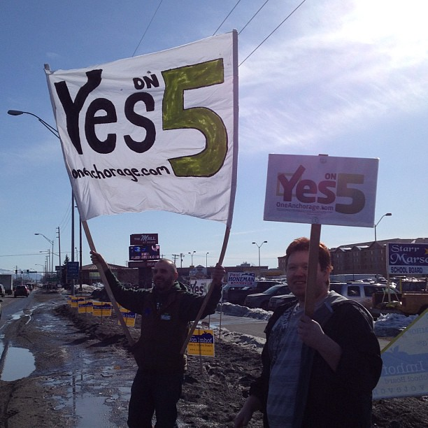 A beautiful day for sign waving: One Anchorage @ N Lts & Seward Hwy. #prop5