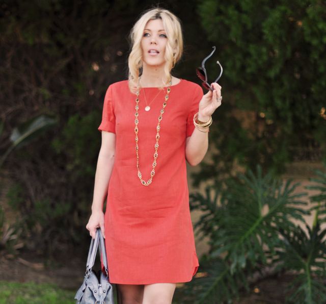 tangerine    shift   dress  with    blue and gold accessories