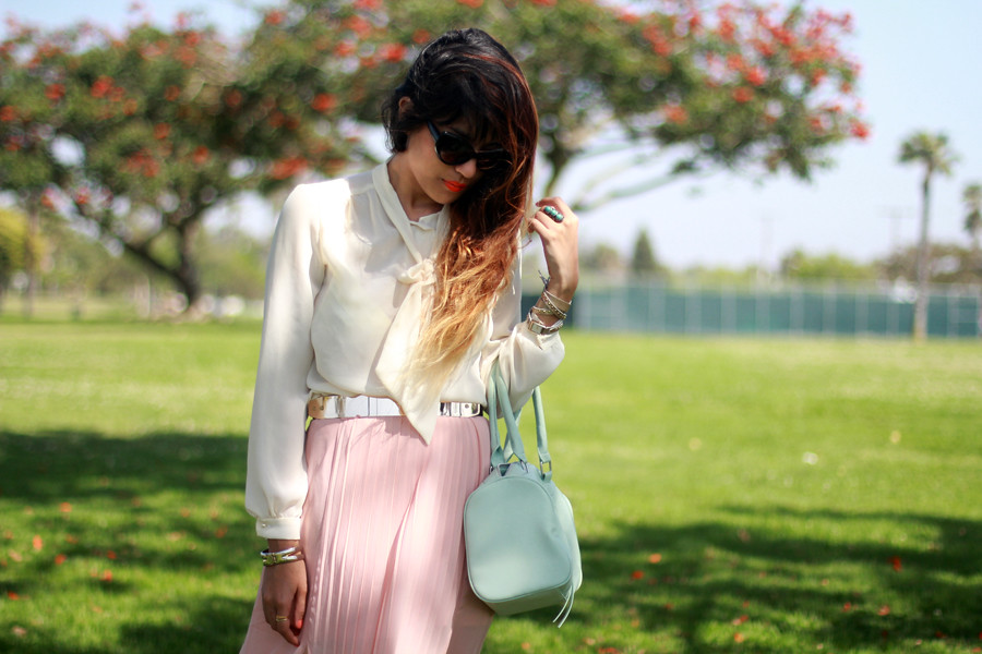 Tarte Vintage semi-sheer chiffon blouse with pearl buttons @ shoptarte.com, Shop Akira Sheer pleated pink skirt with side slit, Glitter ballet flatforms, Cat Eye sunglasses, gold mirrored belt from Beginning Boutique, Mint Satchel