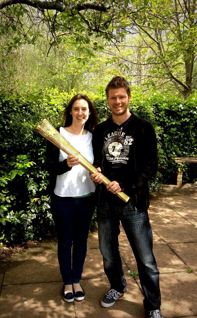 Jason Stanley and Kathryn Stanley holding the London 2012 Olympic Torch