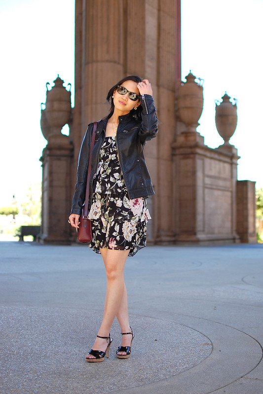 black leather jacket with floral vintage dress