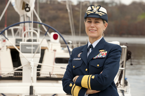U.S. Coast Guard Academy Superintendent Rear Adm. Sandra Stosz stands for a photograph in front of a Coast Guard Leadership 44 pure sail training vessel at the U.S. Coast Guard Academy in New London, Conn. Coast Guard photograph by Petty Officer 1st Class NyxoLyno Cangemi.
