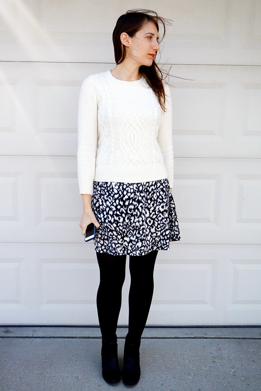 black snow leopard skirt dress and white sweater