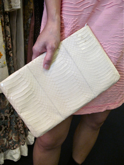Mix textures together! In this case, the texture of this genuine snakeskin clutch nicely offsets the dress's pattern!