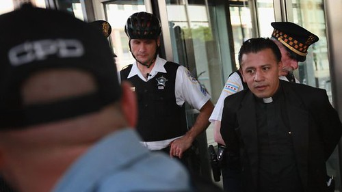 Father Jose Landaverde along with three others were arrested by Chicago police for blocking entrance to an immigration court. The protesters are demonstrating in the lead up to the NATO Summit scheduled to begin on May 20. by Pan-African News Wire File Photos