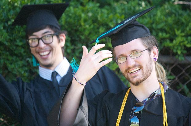 <p>Honolulu CC graduate shares a laugh with a friend</p>