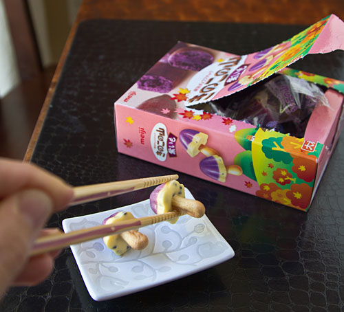 eating candy with chopsticks