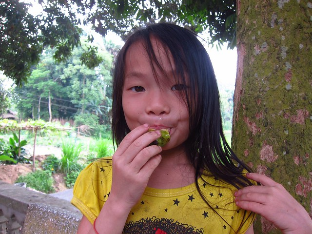 Dao (White Trouser) Girl Eating Green Mango