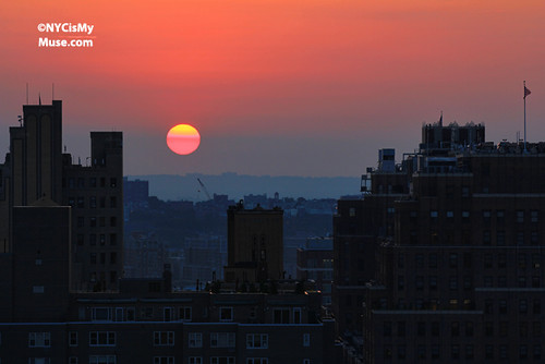 The Day before Manhattanhenge: Pink Ball of fire over the Hudson