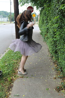 Birthday outfit: tiered dress from Anthopologie, silver flats, studded headband, faux leather biker jacket, snake arm cuff, studded bracelet, bangles, wishbone ring, etc.