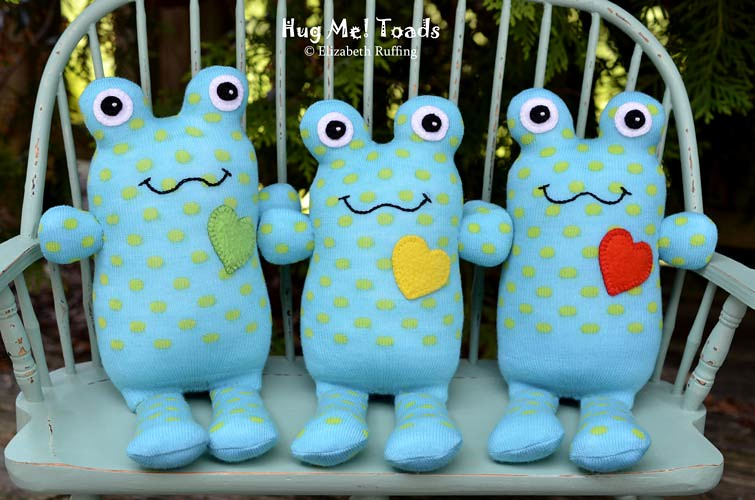 Turquoise Hug Me Sock Toads, with polka dots, original art toys by Elizabeth Ruffing