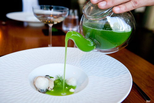 Part of Course 2: Oysters, pouring compressed wheatgrass juice