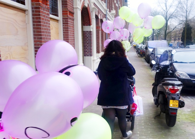 Tala's first birthday walking with balloons