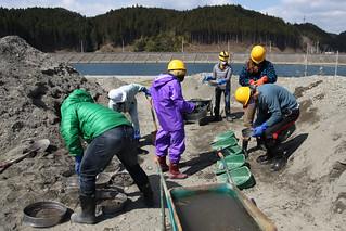 Team #TGSTohoku sifting through rubble with P@CT (Rikuzentakata, Japan)