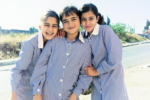 school girls smile happy uniform palestine westbank young territories palestinian vestbredden